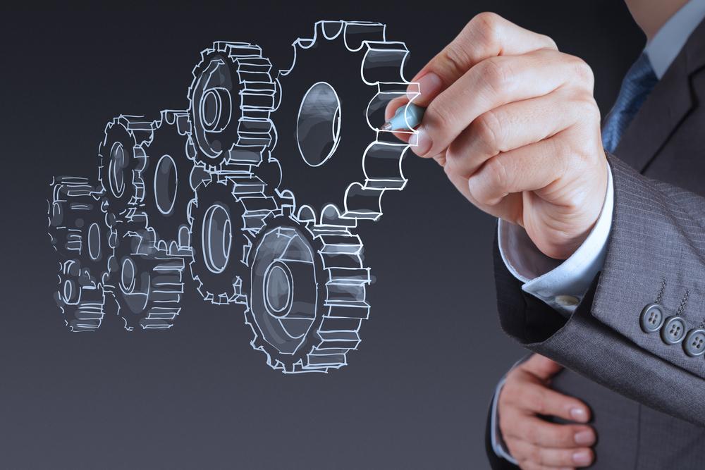 businessman hand draws gear to success concept